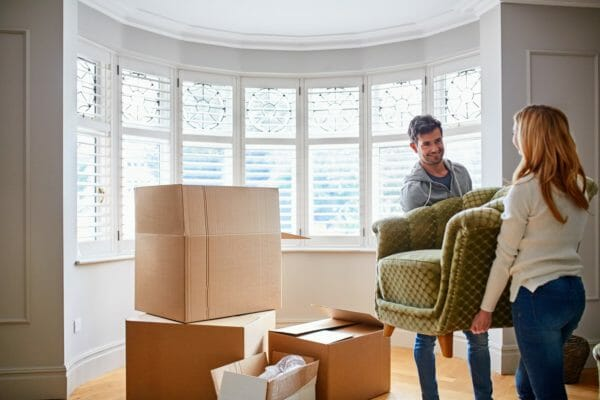 Couple packing carefully to prevent breakages