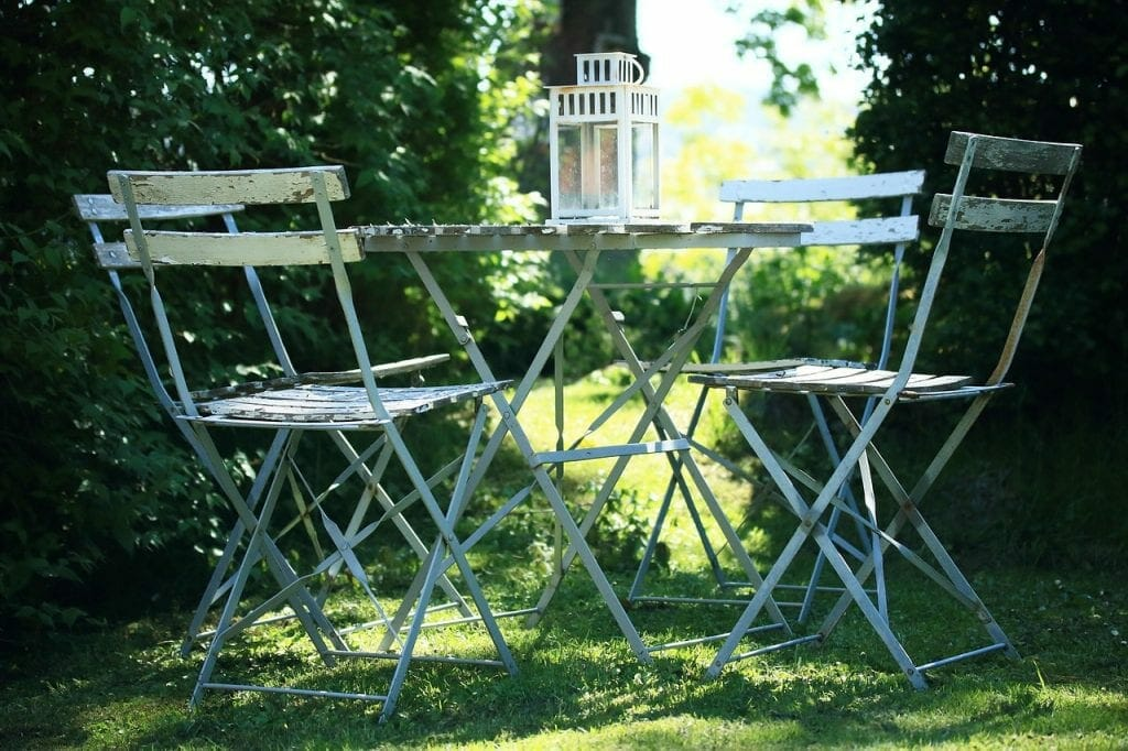 Peaceful garden needing new garden furniture